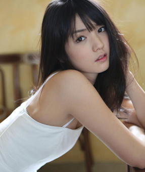 Young Japanese girl in white looking longingly at you