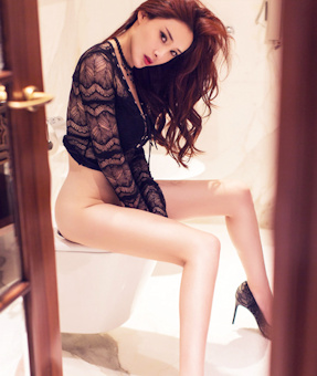 Independent Oriental escort caught in a private moment