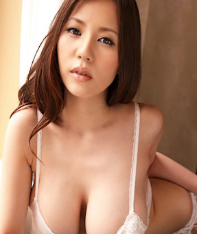 Big bust Oriental escort leaning forward revealing her chest